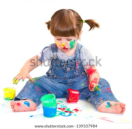 a baby girl artist playing with colors