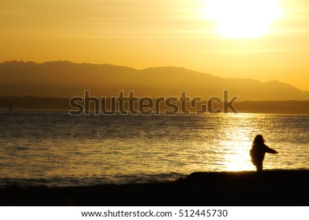A baby girl playing on the beach at sunset: Golden Gardens Park, Seattle (US)