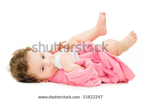 a baby with a bottle - stock photo
