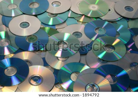 A background image filled with several cd's, cd'roms and dvd's
