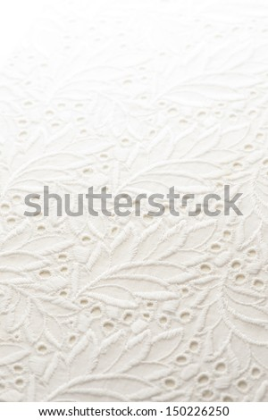 a background image of white lace cloth - stock photo