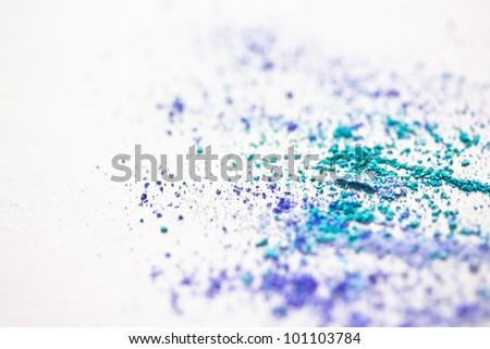 a background made of colourful eyeshadow powder - stock photo