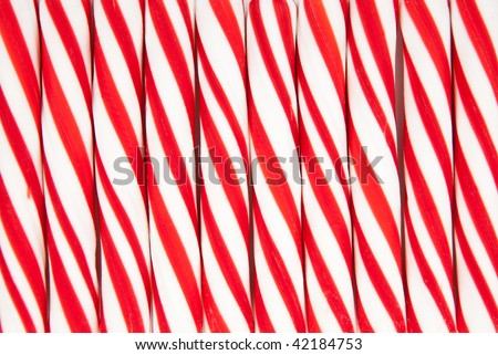 A background made of red and white striped candy canes - stock photo