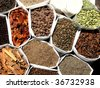 A background of a variety of tropical Indian spices - stock photo
