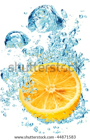 A background of bubbles forming in blue water after orange is dropped into it. - stock photo