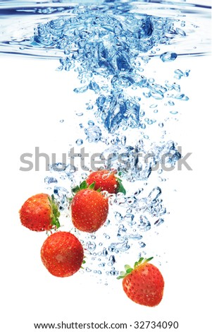 A background of bubbles forming in water after strawberries are dropped into it.