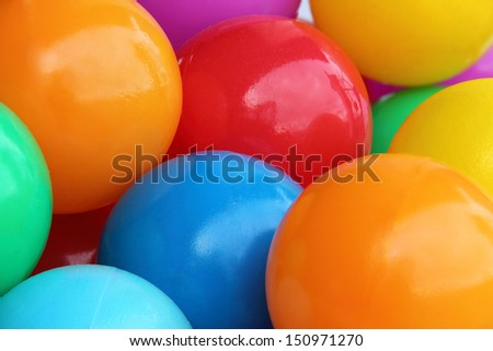 A background of color plastic balls - stock photo