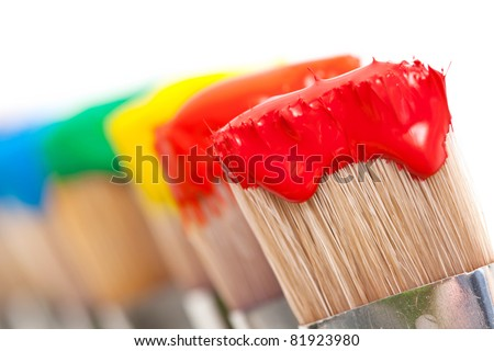 A background of colorful paint on different brushes - stock photo