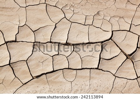 A background of dry cracked mud in the sunshine at Badlands National Park in South Dakota. - stock photo