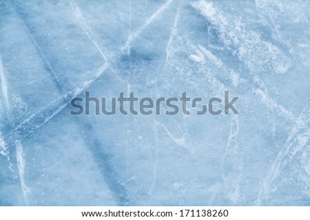 A background of ice surface cut with skate scratches - stock photo