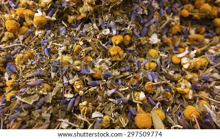 A background of loose herbal tea with lavender, chamomile and lemon verbena. - stock photo