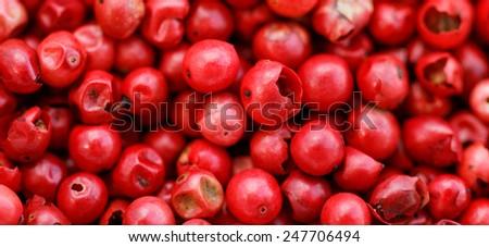 A background of pink peppercorns - macro photo - stock photo