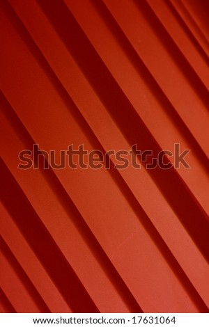 A background of red diagonal stripes.