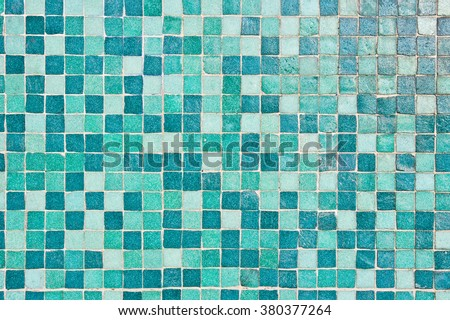 A background of tiles in blue and turquoise tones