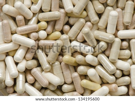 A background of various herbal capsules - stock photo