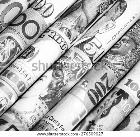 A backgrounds roll of currency,money from many country with black and white color
