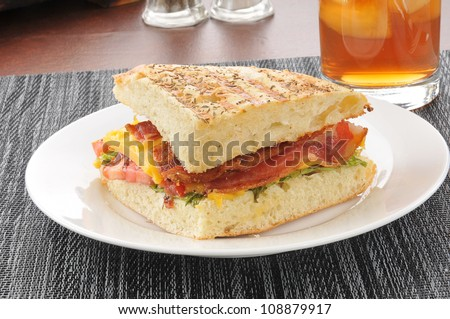 A bacon lettuce and tomato panini on foccia bread
