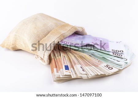 A bag full with euro banknotes isolated on white background - stock photo