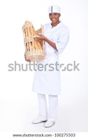 A baker showing off her bread
