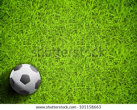 A ball on the green grass of football field