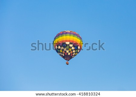 A balloon fly in the blue sky like a symbol of freedom.