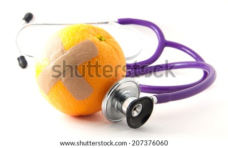 A bandaged orange with a stethoscope. Promoting healthy eating and vitamin C - stock photo