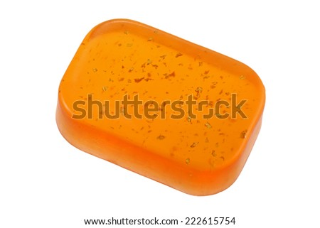 A bar of Glycerin Bar Soap with gold flakes, isolated on white - stock photo
