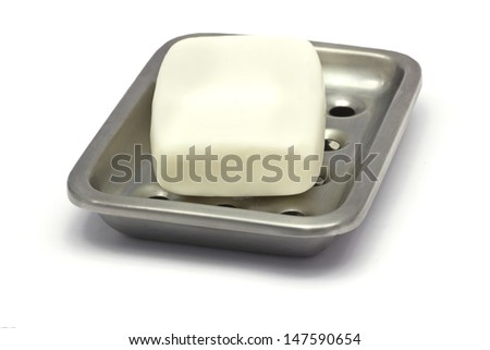A bar of white soap en a gray, silver holder