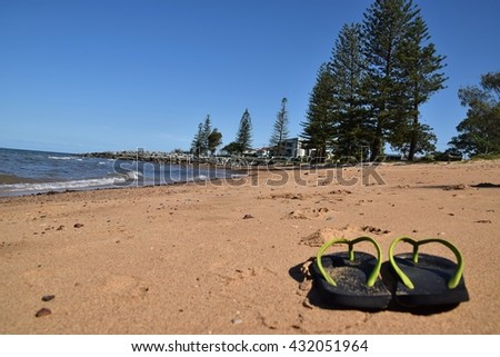 A barefoot walk on the Scarborough beach. - stock photo
