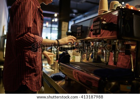 A barista making a coffee