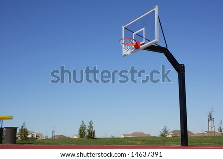 A basket ball hoop on an out door court