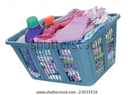 A basket full of laundry. Children's clothes never end. Isolated on white - stock photo