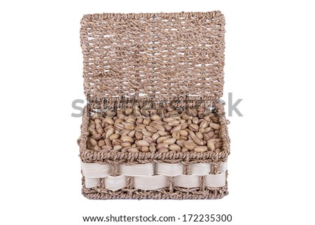 A Basket Full of Pistachios Isolated on a White Background - stock photo