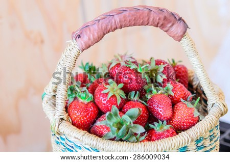 A basket of fresh organic strawberries with vintage background. These strawberries are handpicked from an organic farm in Puyallup, Washington State, US. Panoramic style. - stock photo