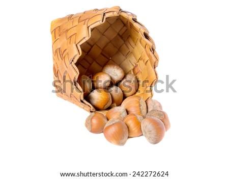 A basket of hazelnuts - stock photo