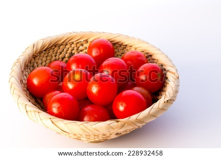 A basket of  Pachino, Italian cherry tomatoes - stock photo