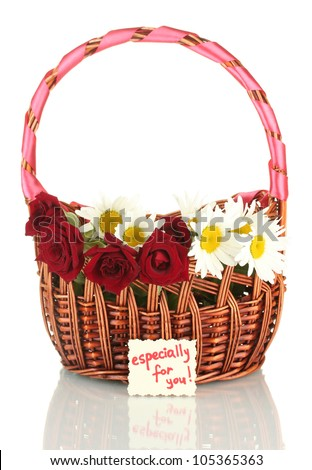 a basket of roses and daisies and a note isolated on white background close-up