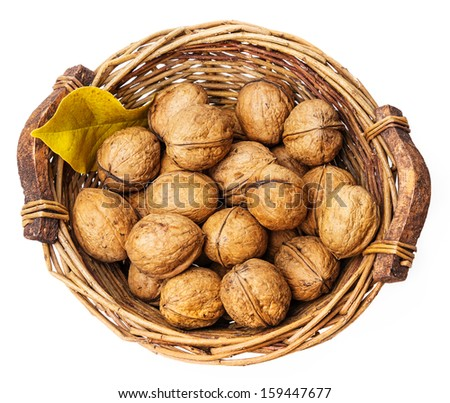 a basket with walnuts on white background