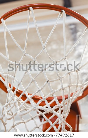 A basketball hoop in a gymnasium - stock photo