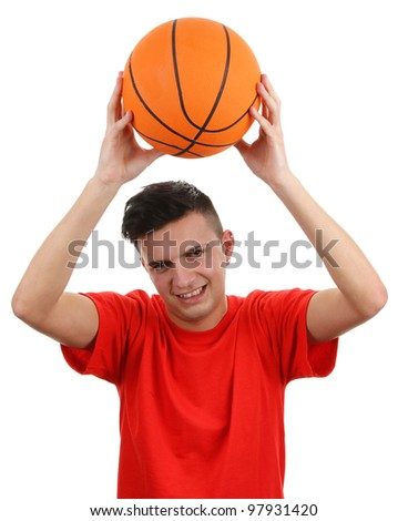 A basketball player holding the ball above his head, isolated on white - stock photo