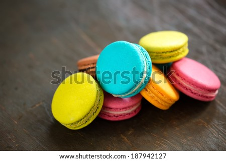 A batch of coloroful French macaroons on a brown table