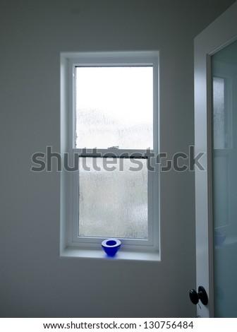 A bathroom plastic window.   Interior design. on - stock photo