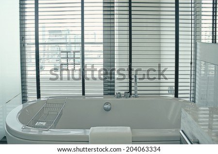 a bathtub with city view - stock photo