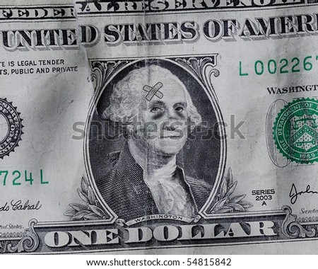 A battered US Dollar where George Washington has black eyes and bandages - stock photo