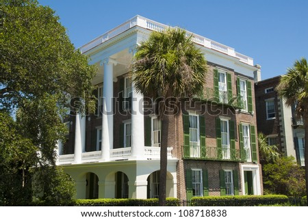 A Bay Street Victorian Single House style of architecture built in the 1800's in Charleston, South Carolina. - stock photo
