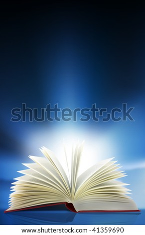A beam of light shines out from an open book