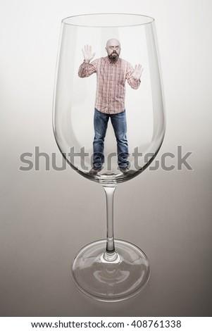 man trapped banco de imágenes fotos y vectores libres de derechos a bearded middle aged man trapped in a glass