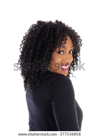 A beautiful African American woman in portrait image, with curly black hair, standing and smiling, isolated for white background.  - stock photo