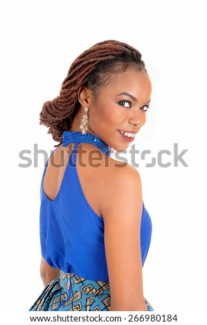 A beautiful African American woman with braided hair looking over her shoulder, in a blue blouse, isolated for white background.  - stock photo