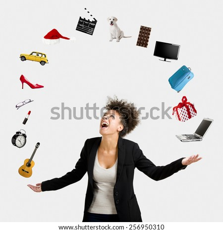 A Beautiful Afro-American woman juggling multiple objects over the air - stock photo